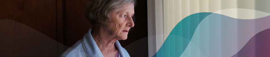Female aged care resident looking out of the window