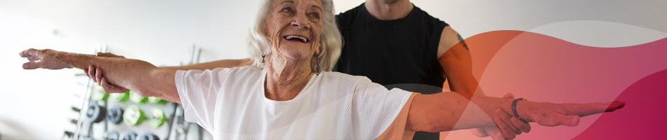 Aged care resident and physio exercising