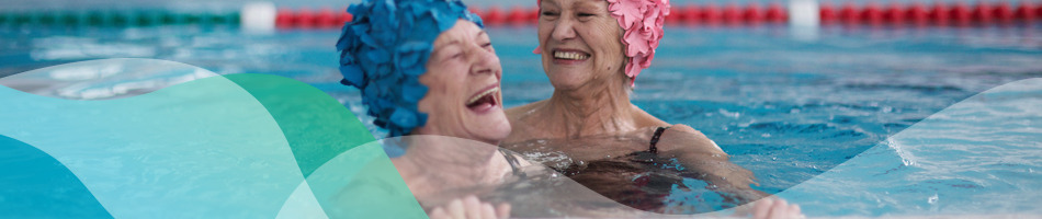 Two aged care home residents in a swimming pool