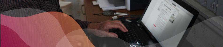 Aged care resident checking financial advice on laptop