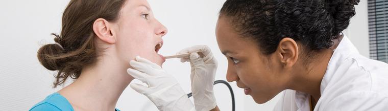 Doctor examining tonsil stones