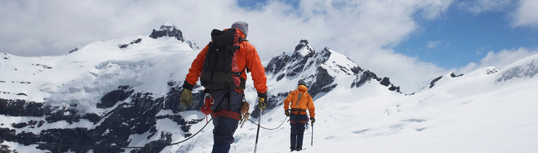 Two hikers walking at high altitude the alps.