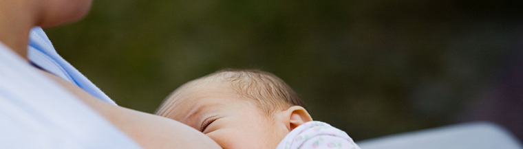 Newborn getting breastfed