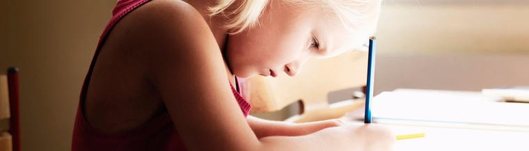 Image of young girl doing homework.