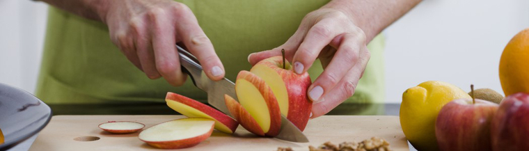 Man cutting fruit