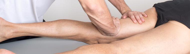Man getting his leg muscles massaged.