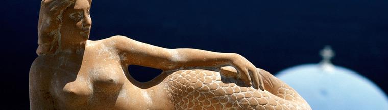 Reclining mermaid statue.