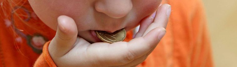 Child with coin.